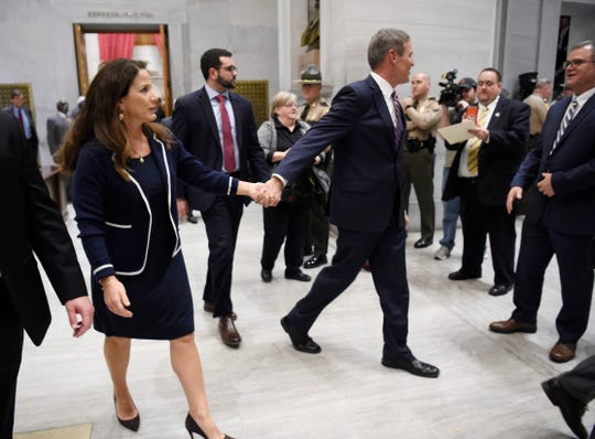 Gov. Bill Lee and his wife Maria hold hands after he delivered his State of the State address at the state Capitol Monday, Feb. 3, 2020 in Nashville, Tenn.