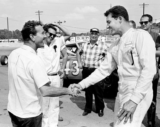 Country Music star Marty Robbins, left, greets Richard Petty after both qualified during the time trials for the Nashville 400 NASCAR race at the Fairgrounds Speedway July 30, 1966. Petty set a track record of 82.49 miles per hour to win the pole.