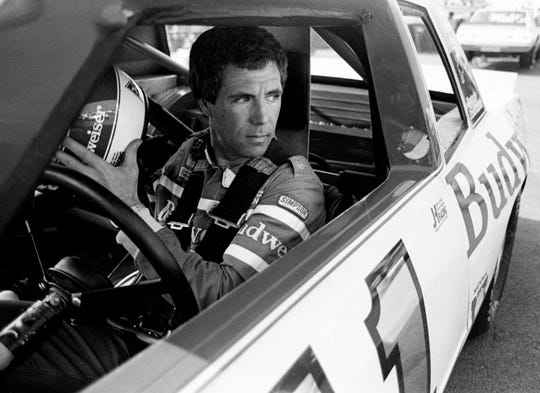 Driver Darrell Waltrip gets ready for the qualifying trials for the Nashville Pepsi 420 NASCAR Grand National race at Nashville International Raceway July 13, 1984. Waltrip will start in the 12th spot for the race.