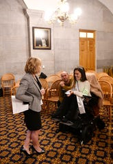 Theresa Nicholls, Director of Special Education Eligibility at Tennessee Department of Education, talks with Megan DeJarnett who is Miss Wheechair TN during Disability Day on the Hill where members and allies of the disability community come together to advocate on behalf of the issues they care about  in Nashville, Tenn. Tuesday, Feb. 4, 2020.