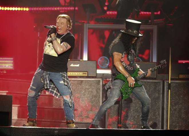 Guns N' Roses' Axl Rose, left, and Slash perform on the first weekend of the Austin City Limits Music Festival at Zilker Park on Friday, Oct. 4, 2019, in Austin, Texas. (Photo by Jack Plunkett/Invision/AP)