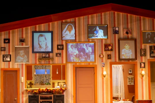 Projected family photos fill frames as they hang on the set of Making God Laugh at Sudden Community Theater in Naples on Tuesday, February 4, 2020. The photos in the frames change throughout the production, showing the passage of time throughout the show.