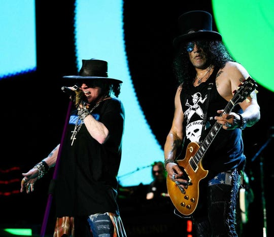 Axl Rose and Slash perform during a 2017 Guns N' Roses concert at Nissan Stadium in Nashville.