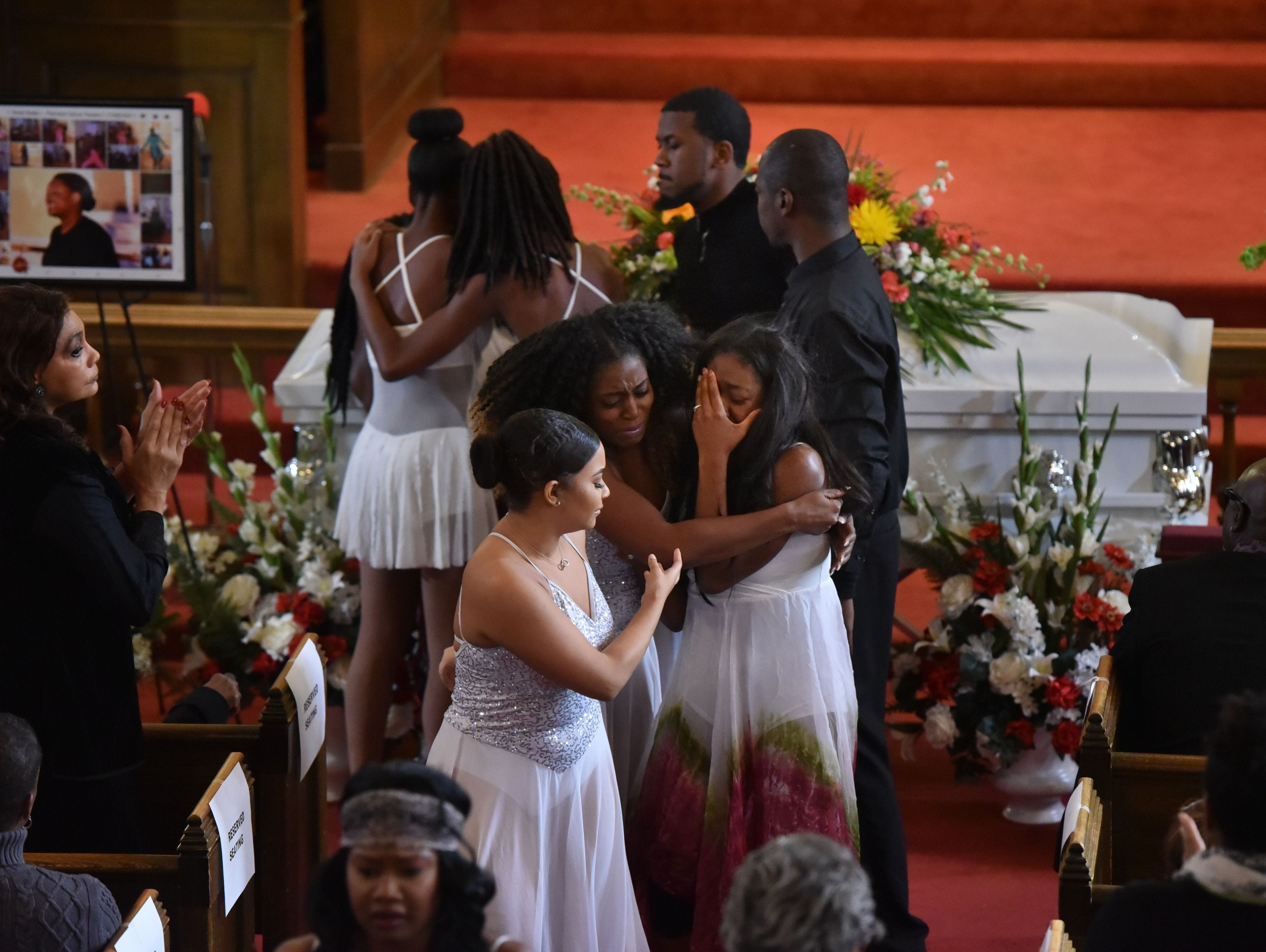 Members of Premiere Dance Theatre become emotional after performing at the funeral for Sarah Butler.