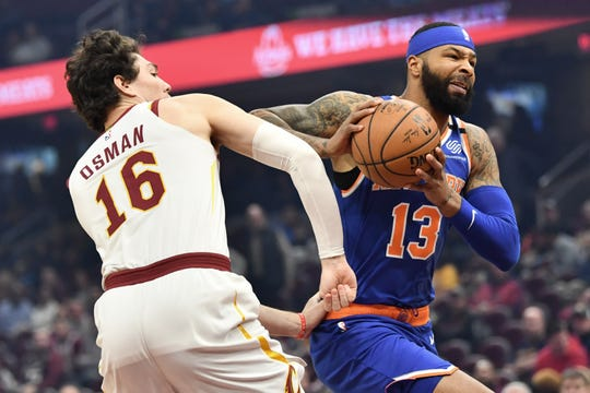 Feb 3, 2020; Cleveland, Ohio, USA;  New York Knicks forward Marcus Morris Sr. (13) drives to the basket against Cleveland Cavaliers forward Cedi Osman (16) during the first half at Rocket Mortgage FieldHouse. Mandatory Credit: Ken Blaze-USA TODAY Sports