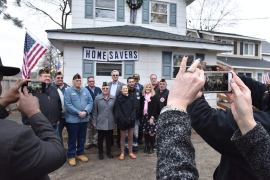 Area veterans gathered in front of Pérez's home on Feb. 4 to support her fight to save her home.