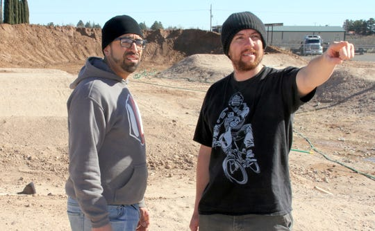 At left, Five-Seven-Five BMX Track Director James Baca and BMX Pro rider Tomas Fernandez look over the layout of the Deming track.