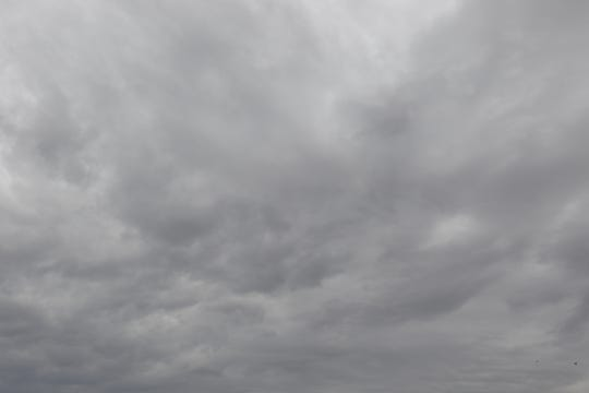 Dark clouds over Carlsbad Tuesday morning were prepared to bring snow to Eddy County.