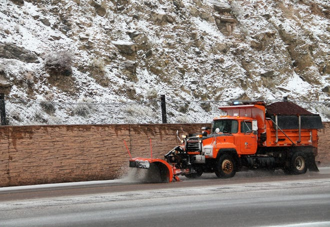 A snow plow makes its way up U.S. Highway 82 Feb. 4.  A winter weather system came through Tuesday, Feb. 4 dropping needed precipitation in Otero County.