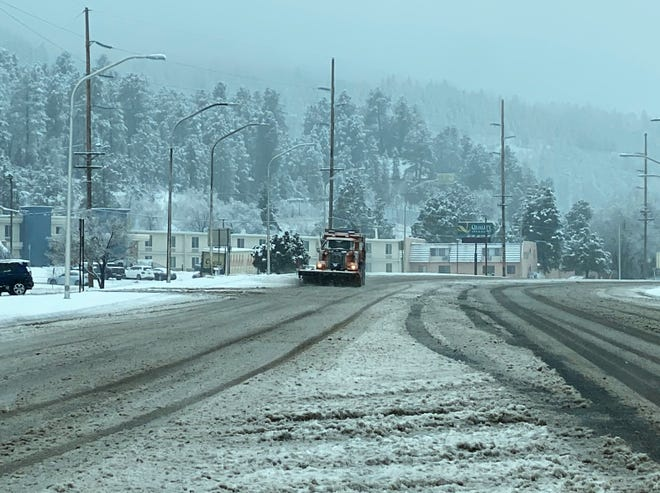Crews clear roads after major snow hit the Village. Some damage, potholes, may be left behind from plows and water seeping into cracks on the road.