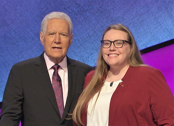 Canton's Kathryn Flucht is pictured with Jeopardy! host Alex Trebek.