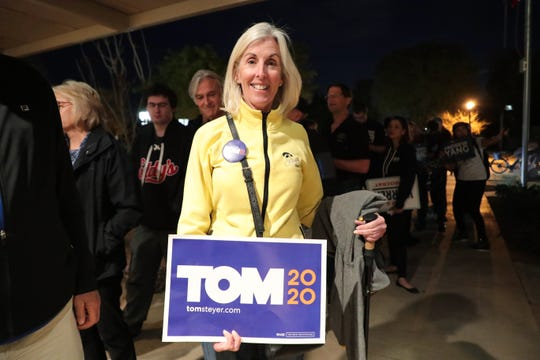 Karen Rathje shows support for Tom Steyer at the 2020 Iowa Democratic satellite caucus at Palm Springs Public Library on Monday, February 3, 2020 in Palm Springs, Calif.
