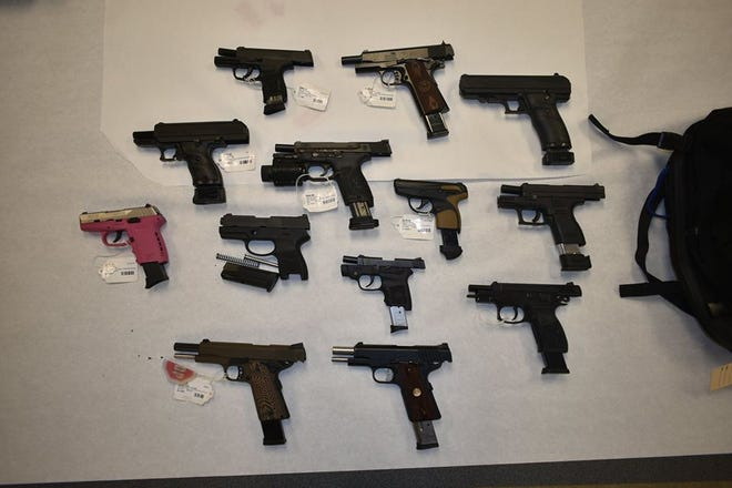 Thirteen guns allegedly stolen from The Pawn Shop of Pensacola Boulevard by Terry Cook on Friday.