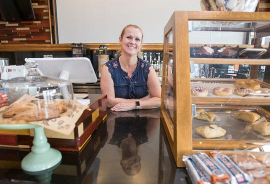 Mido's Coffee Shop owner Kierstyn Hussin poses behind the counter at the new shop on Tuesday.