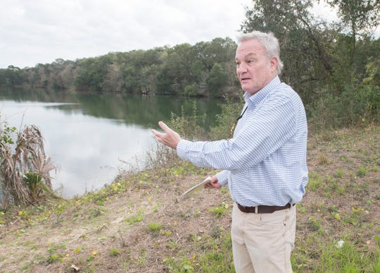 Chips Kirschenfeld, director of Escambia County Natural Resources Management, gives a tour Tuesday of the Jackson Lakes property off of West Navy Boulevard in Warrington.