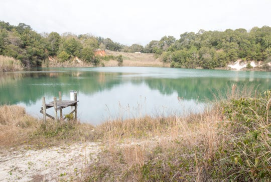 One of three lakes on the Jackson Lakes property owned by Escambia County off West Navy Boulevard in Warrington on Tuesday, Feb. 4, 2020.  The county is considering turning the property into a public nature trail.