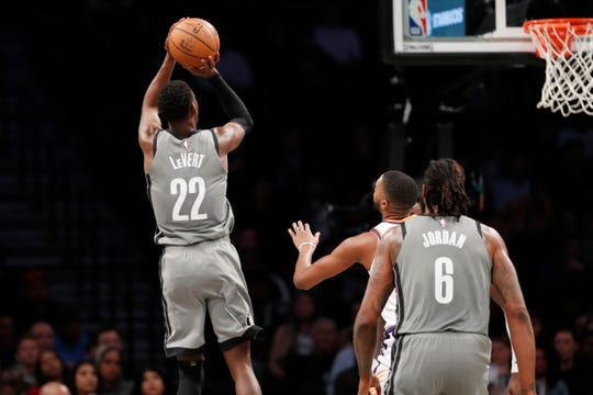 Brooklyn Nets guard Caris LeVert (22) shoots with Brooklyn Nets center DeAndre Jordan (6) lookin on during the second half of an NBA basketball game against the Phoenix Suns, Monday, Feb. 3, 2020, in New York. The Nets defeated the Suns 119-97. (AP Photo/Kathy Willens)