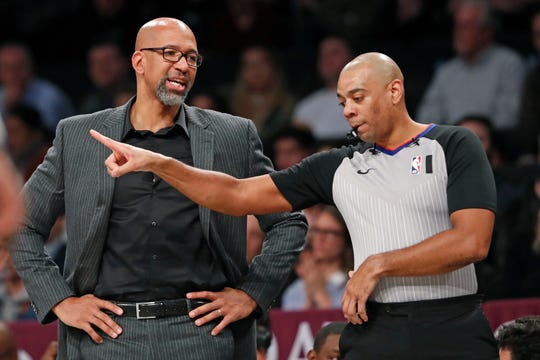 Phoenix Suns head coach Monty Williams, left, talks to an official during the second quarter of an NBA basketball game against the Brooklyn Nets, Monday, Feb. 3, 2020, in New York. (AP Photo/Kathy Willens)
