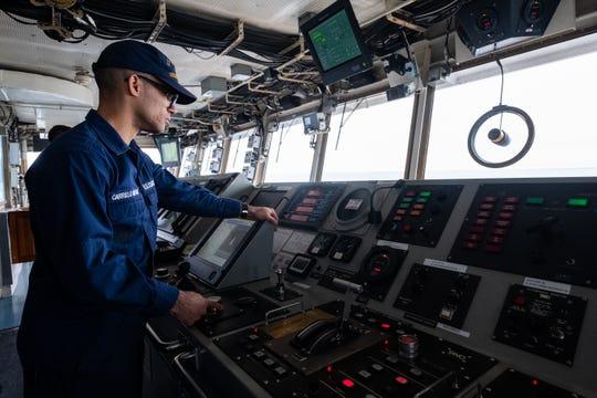 Seaman Elliot Carrillo Rivera operates the USCGC Hollyhock's rudder as the ship sails to Lake Huron for engine testing Tuesday, Feb. 4, 2020.