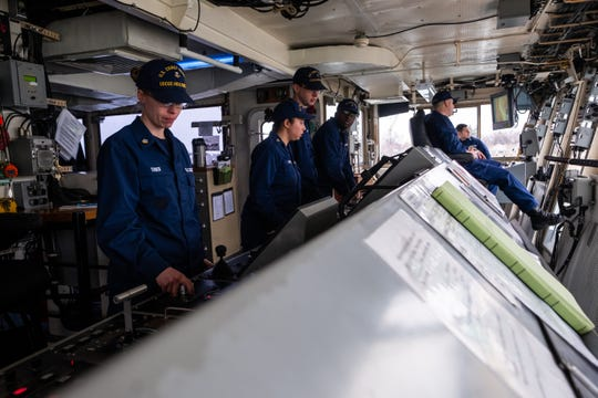 Crewmembers aboard the USCGC Hollyhock work to navigate the ship to Lake Huron for engine testing Tuesday, Feb. 4, 2020, in Port Huron.