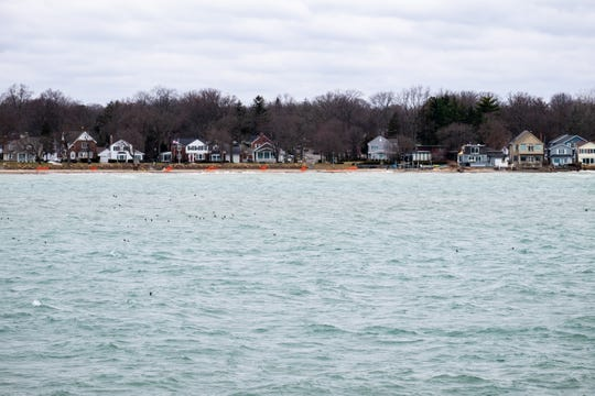 Homes back up to a higher-than-normal Lake Huron. This winter's warm temperatures have led to higher water levels on the Great Lakes.