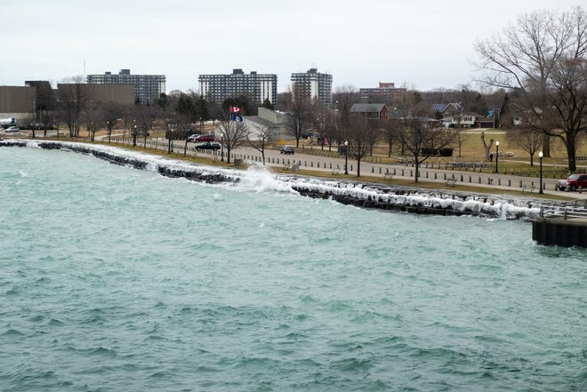 Waves crash against frost-covered rocks along the shore in Sarnia Tuesday, Feb. 4, 2020.