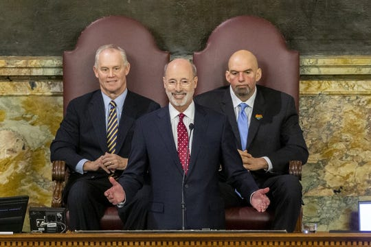 Pennsylvania Gov. Tom Wolf delivers his 2020-21 budget address in the House of Representatives as Speaker Mike Turzai, left, and Lt. Gov. John Fetterman look on, Tuesday, Feb. 4, 2020, in Harrisburg, Pa. Photo by Joe Hermitt/PennLive/The Patriot-News via AP