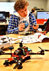 Hanover High School senior Trent Stiller works to build a drone during Drone Construction, Flying & FAA Certification class at Hanover High School, Tuesday, Feb. 4, 2020. Stiller is one of eight students taking the new 90-day course being offered at the school. By the end of the class, students will test to achieve their FAA certification. Dawn J. Sagert photo