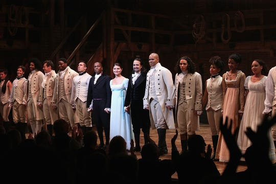 The cast of Hamilton performs the show's Broadway Opening Night at Richard Rodgers Theatre on Aug. 6, 2015 in New York City.  Disney will release a movie version of the play with the original cast in October 2021.