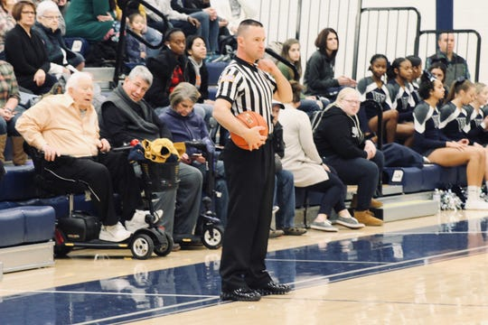 York County basketball official Kevin Lawrence waits as the players prepare for the start of a game. Lawrence wore a microphone for the York Dispatch to help show why youth officials are in decline.