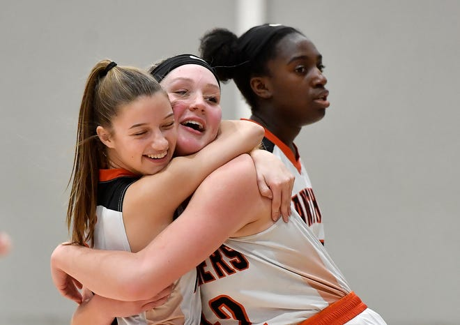 Central York's Abby McFerren, left, and Emily Prowell celebrate after the Panther's defeated Spring Grove 63-60 in overtime, Monday, February 3, 2020.