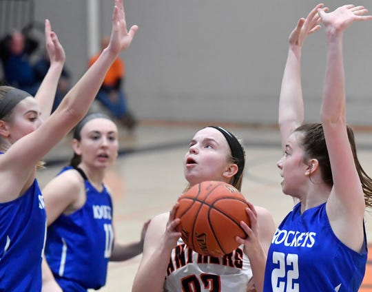 Central York's Sarah Berman cuts between Spring Grove's Lexi Hoffman, left, and Ella Kale, to hit what would be the winning basket for Central in overtime on Monday, Feb. 3. Both Central and Spring Grove have qualified for the District 3 playoffs. John A. Pavoncello photo