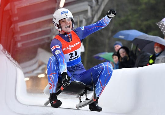 Summer Britcher of Glen Rock, Pennsylvania, cheers at the finish line after finishing third at the luge world cup in Oberhof, Germany, Sunday, Feb.2, 2020.