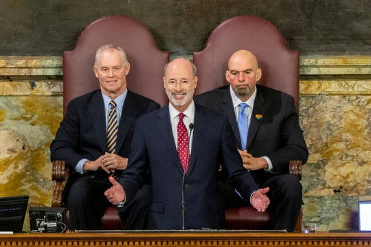 Pennsylvania Gov. Tom Wolf delivers his 2020-21 budget address in the House of Representatives as Speaker Mike Turzai, left, and Lt. Gov. John Fetterman look on, Tuesday, Feb. 4, 2020, in Harrisburg.