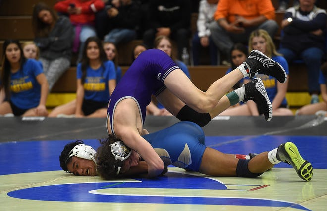 Spanish Springs' Devin Griffen, top, takes on Reed's Marley Peros during their wrestling meet at Reed in Sparks on Jan. 29, 2020.
