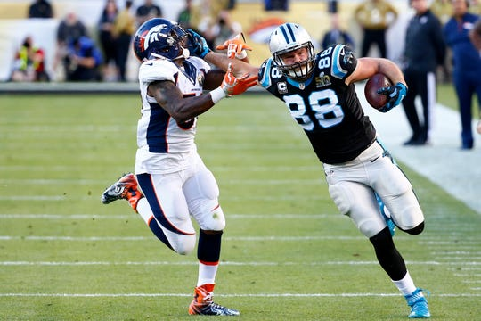 Greg Olsen #88 of the Carolina Panthers runs after a catch against  Danny Trevathan #59 of the Denver Broncos in the first half during Super Bowl 50 at Levi's Stadium on February 7, 2016 in Santa Clara, California.