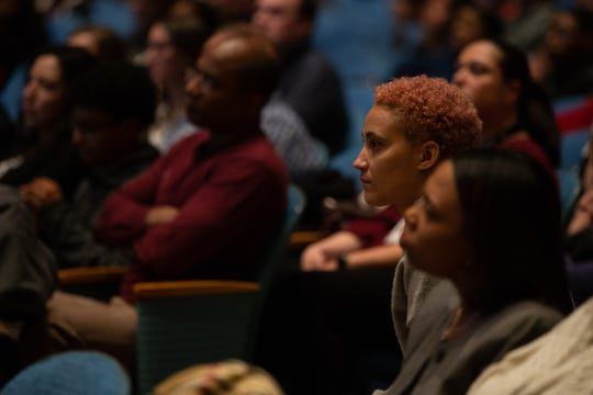 Jess Coleman of Rochester listens to Sean Eversley Bradwell, an assistant professor at Ithaca College, as he leads a discussion on the origins and usage of the N-word on Monday, Feb. 3, 2020, at Greece Olympia High School.