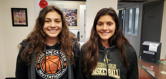 Enterprise seniors Kylie Mendes (left) and Natalie Mendes (right) at their school's main office on Tuesday.