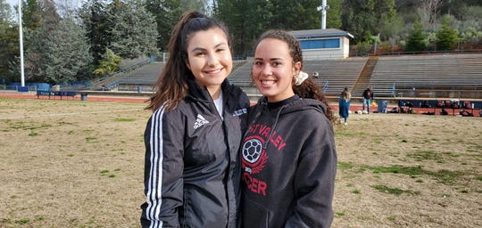 West Valley junior forward Bianca Jones (left) and sophomore forward Taylor King pose at Central Valley High School before facing the Falcons on Tuesday.
