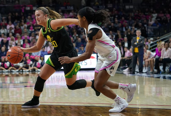Oregon Ducks guard Sabrina Ionescu (20) drives the ball against UConn Huskies guard Crystal Dangerfield (right) in the second half at Harry A. Gampel Pavilion. Oregon won 74-56.