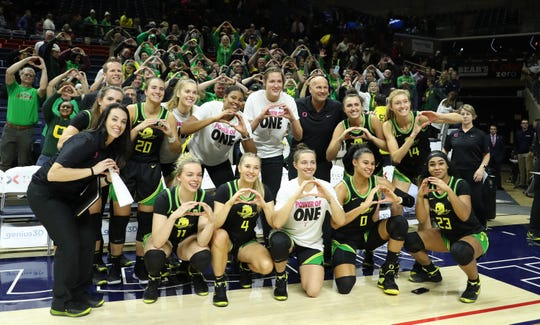 The Oregon Ducks and fans pose for a picture after defeating the UConn Huskies at Harry A. Gampel Pavilion. Oregon won 74-56.
