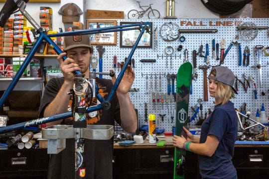 Justin Benguerel, 22, and Javien Franz, 18, service bikes and skis at Fall Line Sports in Silverton on January 30, 2020.