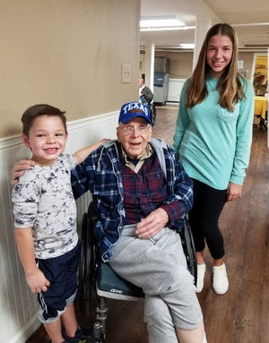 Frank Deloria sits with his great-grandchildren, Connor and Kelly Baxter. Deloria passed away Sunday, Feb. 2, 2020.