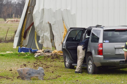 Law enforcement officers are on the scene of where a police chase ended Monday, Feb. 3, 2020, on Caspiana Levee Road. The vehicle driven by suspects crashed into a Caddo Parish fire station.