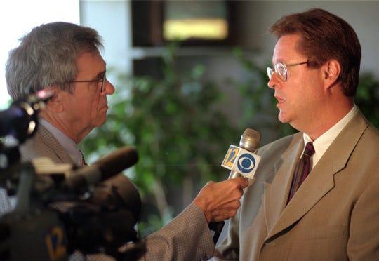 Bob Griffin, of KSLA TV, interviews John C. York II of Youngstown, Ohio, executive vice president of DeBartolo Racing in 1997.