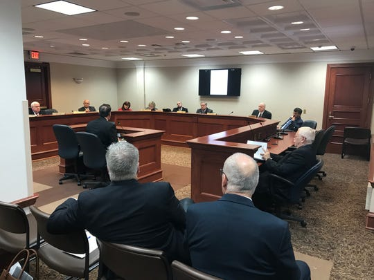 Lt. Gov. Larry Rhoden testifies against a red flag law, Senate Bill 82, before the Senate Judiciary Committee on Tuesday as NRA lobbyist Brian Gosch and Rep. Ernie Otten, R-Tea, watch from the audience. Otten's wife also testified in opposition on Tuesday.