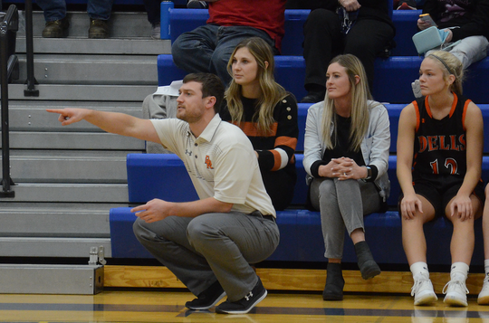 Dell Rapids JV coach Dustin Steckler gives direction to his team as head varsity coach Taylor Trohkimoinen (behind) and assistant coach Haley Brown look on against Baltic on Feb. 3, 2020.