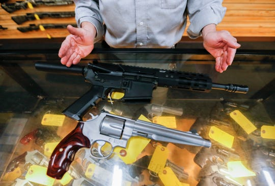 A Smith and Wesson model 629 .44 Magnum revolver next to an AR-15 pistol at Cherokee Firearms on Monday.