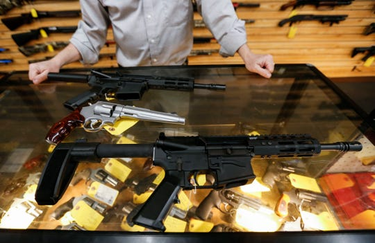 AR-15 pistols with a Smith and Wesson model 629 .44 Magnum revolver at Cherokee Firearms on Monday.