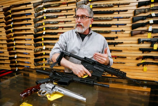 """Nick Newman, owner of Cherokee Firearms in Springfield, shows how an AR-15 pistol with a forearm brace is used at his store on Monday. The Missouri Department of Conservation has rewritten its definition of """"handgun"""" as more hunters are using AR-style pistols to hunt."""
